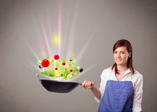 Young woman cooking fresh vegetables Royalty Free Stock Photography