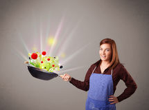 Young woman cooking fresh vegetables Royalty Free Stock Photo