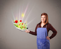 Young woman cooking fresh vegetables Stock Image