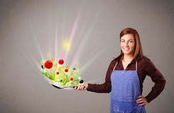 Young woman cooking fresh vegetables Royalty Free Stock Image