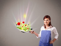 Young woman cooking fresh vegetables Stock Photography