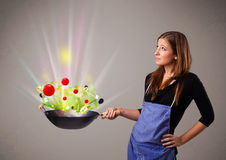 Young woman cooking fresh vegetables Royalty Free Stock Images
