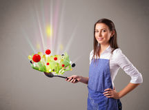 Young woman cooking fresh vegetables Stock Photos