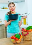 Young woman cooking with fun. Royalty Free Stock Images