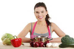 Young woman cooking healthy food Royalty Free Stock Photography