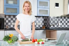 Young Woman Cooking. Healthy Food - Vegetable Royalty Free Stock Images