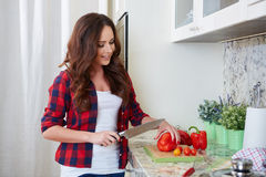Young Woman Cooking. Healthy Food. Vegetable Salad. Diet. Dieting Concept. Healthy Lifestyle. Cooking At Home. Prepare Food royalty free stock photo