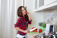 Young Woman Cooking. Healthy Food. Vegetable Salad. Diet. Dieting Concept. Healthy Lifestyle. Cooking At Home. Prepare Food royalty free stock photos