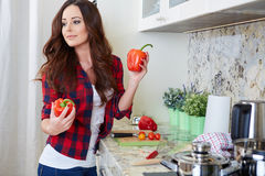 Young Woman Cooking. Healthy Food. Vegetable Salad. Diet. Dieting Concept. Healthy Lifestyle. Cooking At Home. Prepare Food stock photography