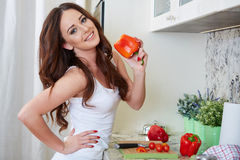 Young Woman Cooking. Healthy Food. Vegetable Salad. Diet. Dieting Concept. Healthy Lifestyle. Cooking At Home. Prepare Food royalty free stock images