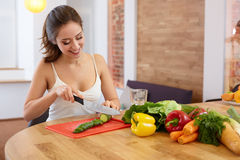 Young Woman Cooking. Healthy Food - Vegetable Salad. Diet. Healt Royalty Free Stock Photo