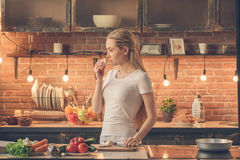 Young woman cooking healthy fresh meal at home Stock Photos