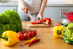 Young woman cooking healthy meal in the kitchen. Cooking healthy food at home Stock Photo