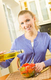 Young woman cooking at home Stock Photo