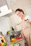 Young woman cooking in the kitchen Royalty Free Stock Photo