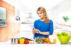 Young woman cooking in the kitchen. Royalty Free Stock Image