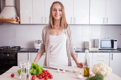Young Woman Cooking in the kitchen. Dieting vegetarian concept. Healthy Lifestyle. Cooking At Home. Prepare Food stock photography