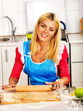 Young woman cooking at kitchen. Royalty Free Stock Photo