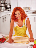 Young woman cooking at kitchen. Royalty Free Stock Images