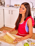 Young woman cooking at kitchen. Royalty Free Stock Photos