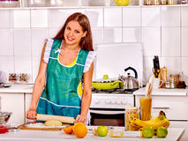 Young woman cooking at kitchen Royalty Free Stock Photography
