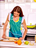Young woman cooking at kitchen Stock Photos