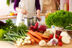 Young Woman Cooking in the kitchen. Healthy Food Royalty Free Stock Image