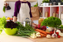 Young Woman Cooking in the kitchen. Healthy Food.  Stock Photography