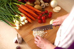Young Woman Cooking in the kitchen. Healthy Food Royalty Free Stock Photography