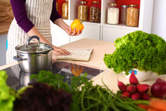 Young Woman Cooking in the kitchen. Healthy Food Stock Image