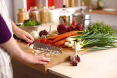 Young Woman Cooking in the kitchen. Healthy Food Royalty Free Stock Images