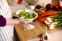 Young Woman Cooking in the kitchen. Healthy Food Stock Photos
