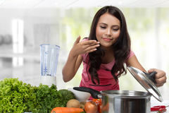 Young Woman Cooking in the kitchen. Healthy Food Diet. Cooking At Home. Prepare Food stock photo
