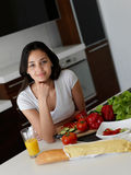 Young Woman Cooking in the kitchen Royalty Free Stock Image