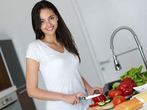 Young Woman Cooking in the kitchen Royalty Free Stock Photography
