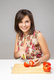 Young Woman Cooking in the kitchen Stock Images
