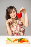 Young Woman Cooking in the kitchen. Royalty Free Stock Images