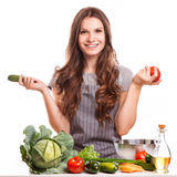 Young Woman Cooking in the kitchen. Healthy Food - Royalty Free Stock Photos