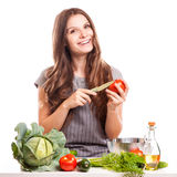 Young Woman Cooking in the kitchen. Healthy Food - Royalty Free Stock Images