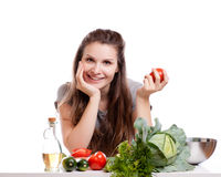 Young Woman Cooking in the kitchen. Healthy Food - Royalty Free Stock Photography