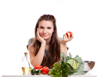 Young Woman Cooking in the kitchen. Healthy Food - Stock Photos
