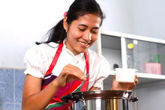 Young woman cooking in the kitchen Stock Image