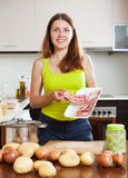 Young woman  cooking with lamb meat Stock Photos