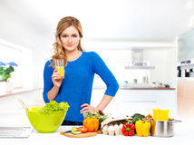 Young woman cooking in a modern kitchen Stock Photography