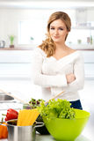 Young woman cooking in a modern kitchen Stock Photo