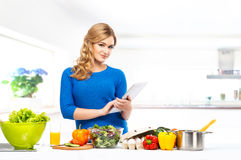 Young woman cooking in a modern kitchen Stock Images