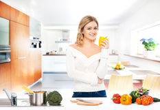Young woman cooking in a modern kitchen Royalty Free Stock Image