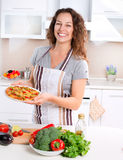 Young Woman Cooking Pizza Stock Image