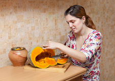 Young woman cooking pumpkin Royalty Free Stock Photo