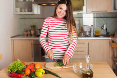 Young Woman Cooking Vegetable Salad Royalty Free Stock Image